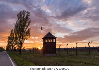 Gun towers at concentration camp in Auschwitz II - Birkenau at sunset