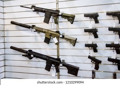 Gun wall rack with rifles and pistol.