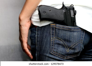 Gun in woman Jeans pocket, dangerous for many reasons