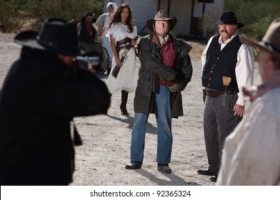 A gunfight is about to begin in an old western town.