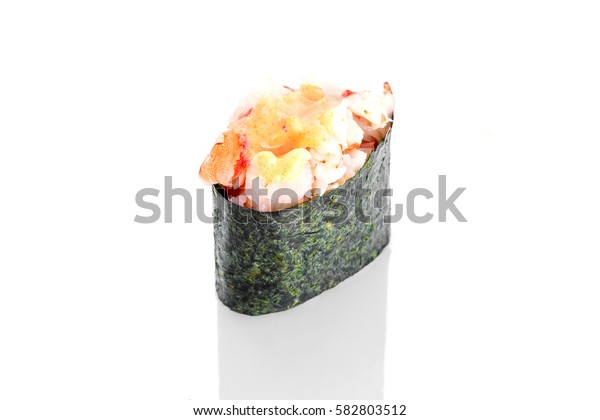 Gunkan Sushi with shrimps and spicy sauce on a white background