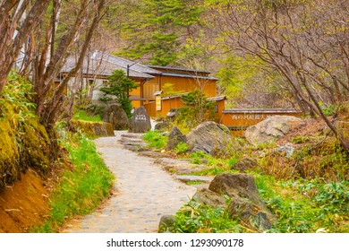 Gunma, Japan - April 27 2018: Sainokawara Open-Air Bath is opened year-round and accessible for a small fee. Located within Sainokawara Park in the hot spring resort town of Kusatsu
