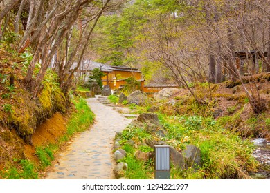 Gunma, Japan - April 27 2018: Sainokawara Open-Air Bath open year-round and accessible for a small fee. Located within Sainokawara Park in the hot spring resort town of Kusatsu