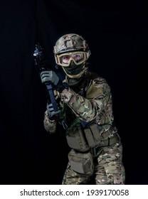 Gunman in helmet wielding rifle