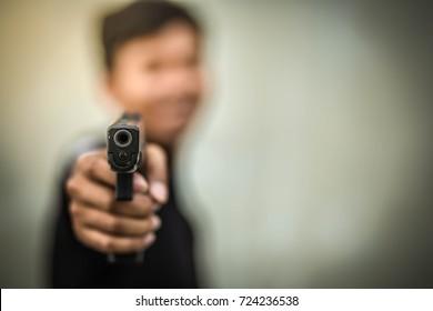 The gunman killer was aiming his gun at the target.