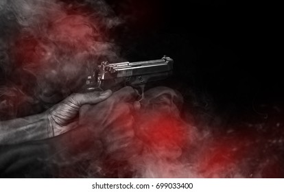 Gunman shooting gun in hand. The killer leads to the death of his enemy./select focus