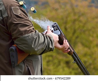 gunman with smoking shotgun after a shot