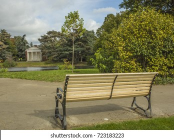 Gunnersbury Park. A bench and path in this large park in west London popular with dog walkers and runners