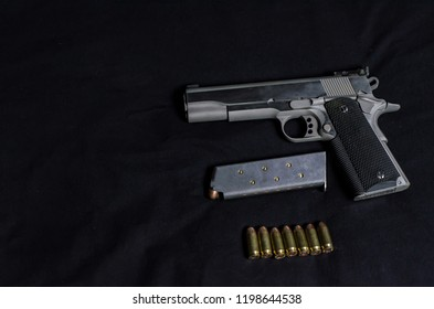 Guns and ammunition are placed on a black background.Monochrome tone.Do not focus on objects