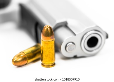 Guns and ammunition are placed on white ground.