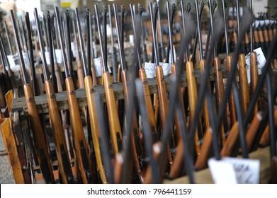 guns arranged in lines