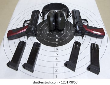 Guns cartridges target headset in a shooting range