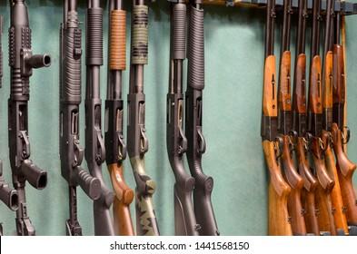 guns in gun shop on green background