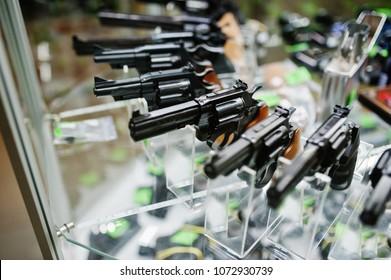 Guns on shelves