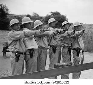 The guns that protect the President. Members of the White House police force that are taking part in the third annual marksmanship match. August 2, 1938.