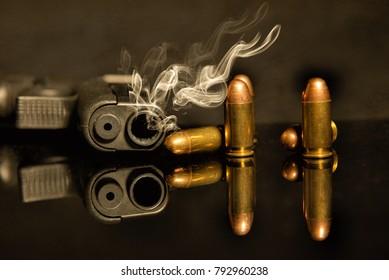 Gunshot handgun Guns and ammunition, 11 mm on the table.