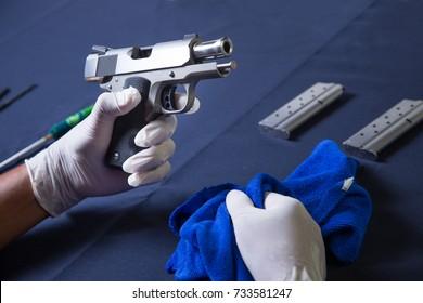 Gunsmith assemble hand gun pistol and cleaning