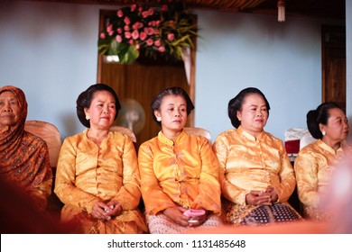 GUNUNG KIDUL APRIL 2014 - Group of an old women are wearing kebaya wedding clothes with authentic konde and sanggul, a traditional hair do for formal ceremony in Yogyakarta