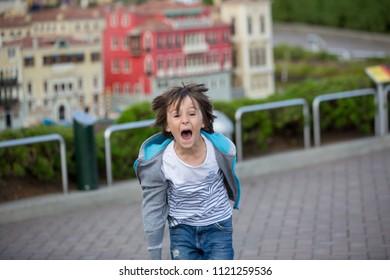 GUNZBURG GERMANY, LEGOLAND RESORT - JUNE 25, 2018: Legoland resort. Young child, having fun in Legoland family fun and entertainment resort