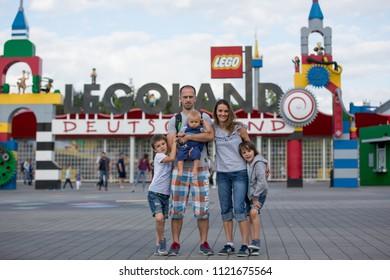 GUNZBURG GERMANY, LEGOLAND RESORT - JUNE 25, 2018: Legoland resort. Family standing in front of the entrance at Legoland Theme park.Family fun on holidays.