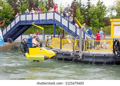 GUNZBURG GERMANY, LEGOLAND RESORT - JUNE 25, 2018: Legoland resort. People enjoying one of the many rides at Legoland Theme park.Family fun on holidays.
