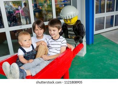 GUNZBURG GERMANY, LEGOLAND RESORT - JUNE 24, 2018: Legoland resort. Children enjoying one of the many decoration figurines made from lego blocks at Legoland Theme park.Family fun on holidays.