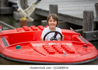 GUNZBURG GERMANY, LEGOLAND RESORT - JUNE 24, 2018: Legoland resort. Child enjoying boat riding at Legoland Theme park.Family fun on holidays.