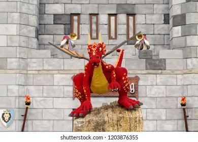 GUNZBURG, GERMANY - October 06, 2018: red dragon made lego bricks at the hotel entrance, Legoland resort, The Knight Castle Hotel