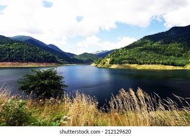 Gura Apei accumulation lake in Retezat Mountains, Romania.