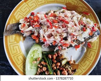 Gurami Sambal Matah, Balinese food fried fish with raw sauce mixed of onion, garlic and chili