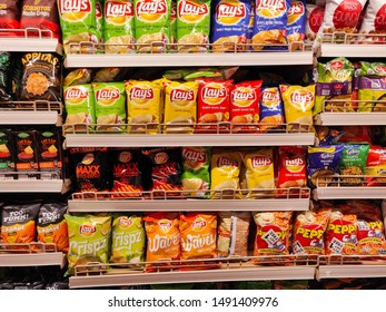 Gurgaon, Haryana India - 07/25/2019: Packets of chips by Lays brand displayed indoors in a supermarket. Packaged potato wafers.