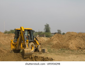 Gurgaon, Haryana, India - January 28, 2017: Earth moving equipment near Damdama lake in Gurgaon, Haryana (India)