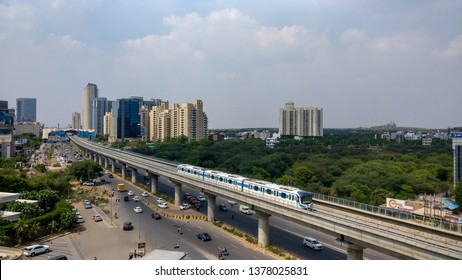 Gurgaon, India, 2019. Aerial shot of Rapid metro tracks in urban areas of Delhi NCR, Gurgaon, Noida with metro running on the tracks.