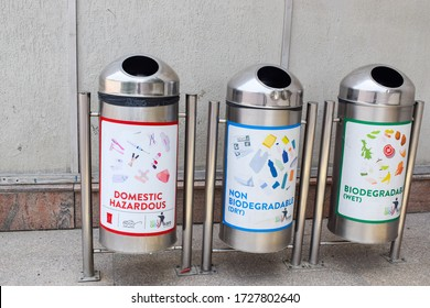 Gurgaon, India 2020: Metallic dustbin with indication of type of waste to be put in each bin. Waste segregation is a key to waster management