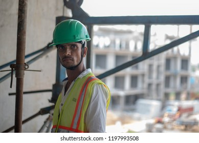 Gurgaon, India - August 08 2018: Labourers working in an urban construction site.