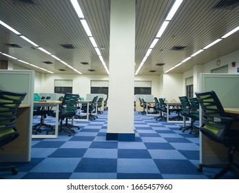Gurgaon, India Circa 2020 - Colorful new office or library or reading room to study with cubicles, chairs, tables and carpets. The room has open spaces for people to colaborate and work together