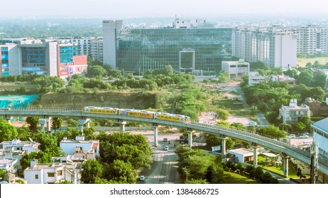 Gurgaon, India - Oct 21, 2016 - Ariel view of urban landscape along with Rapid Metro system, Gurugram