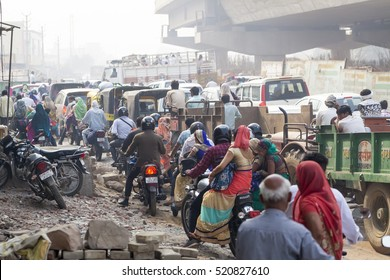Gurgaon November 2016 : Traffic on the streets of a big mess. Taxis, mopeds and pedestrians cross without any order. Gurgaon, India, November 1, 2016