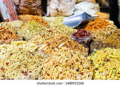 Gurgaon/Gurugram, Haryana, INDIA - 25 July, 2019 : Unidentified street vendor selling snacks and sweet to rural people at weekly market in village