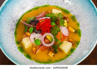 Gurman Soup with salmon and vegetables served cilantro - Shutterstock ID 1699424038