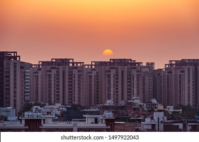 Gurugram, Haryana, India - 04/10/2019: Apartment building and plot houses exterior view during sunset over an urban cityscape.