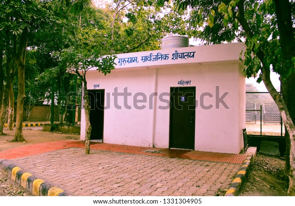 GURUGRAM, HARYANA, INDIA - FEB 14, 2019: The Ladies and Gents Public Toilet Outdoor -image.