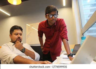Gurugram, India - July 9,2018 : Young Indian Techies working in a startup office with laptop.