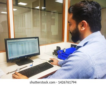 Gurugram/Gurgaon, Haryana, India - 15 March,2019:Automotive Engineer Working on a Personal Computer. He Works in the Bright and Modern Office .