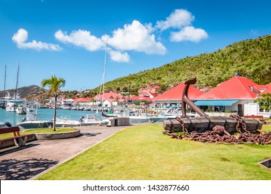 Gustavia, harbor landscape with red rooftop buildings. Saint Barthelemy, St Barts, St Barths.