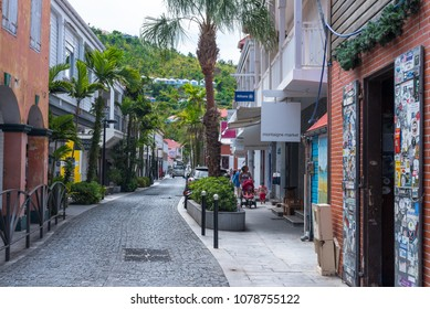 Gustavia, St Barths-- April 25, 2018. A pretty cobblestone street with retail stores on either side winds its way through  Gustavia, St. Barths. Editorial Use Only.