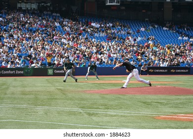 Gustavo Chacin throwing out a pitch against the Tampa Bay Devil Rays