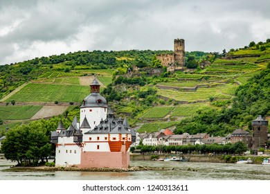 Gutenfels Castle above the Rhine River and the village of Kaub, Germany.  Also in forground, a customs station in the Rhine river, built in 1326.