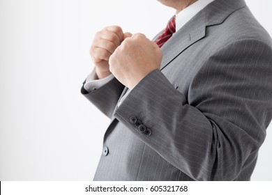 A guts pose businessman, middle aged man