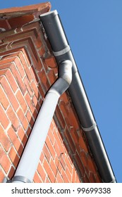 guttering and drain or rain pipe on house. architecture detail on home